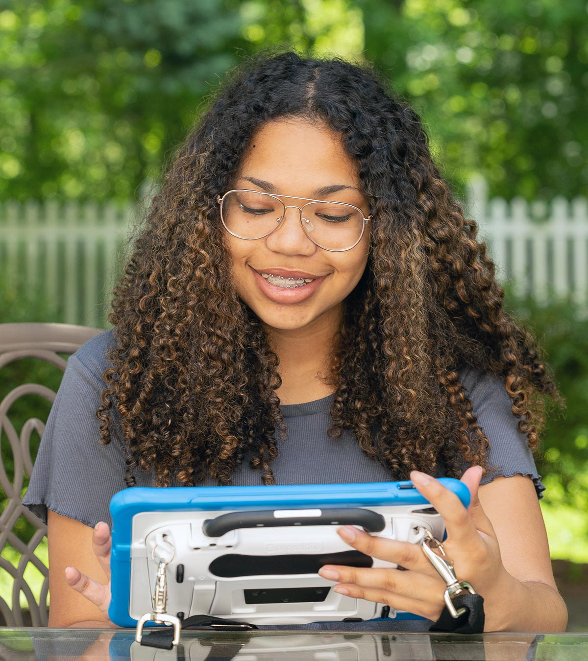 Image of a girl using a speech device